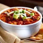 Quick and Healthy Turkey Chili - In just 30 minutes, you'll have a mouthwatering pot of healthy, nourishing chili that tastes like it's been simmering for hours. Top with cheese, avocado, and cilantro for heaven in a bowl.