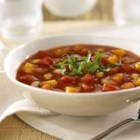 Fragrant Autumn Vegetable Soup - A hearty, colorful vegetable soup made with butternut squash, tomatoes, cannellini beans and corn with a delectable flavor and fragrance coming from a dash of cinnamon. Recipe concept developed by The Culinary Institute of America.