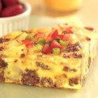 Sausage Frittata - Delicious for brunch or a quick week-night dinner, this frittata with sausage, potatoes, and Parmesan cheese is topped with chopped tomato and sliced green onion.