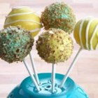 Cake Pops by Duncan Hines(R) - Mini-bites of candy-coated Duncan Hines cake sit playfully atop lollipop sticks. The decorating possibilities are endless with these tasty treats.