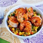 Shrimp and Sweet Corn Maque Choux - A spicy Southern dish, Shrimp & Sweet Corn Maque Choux is satisfying and ready in under 30 minutes. This is my recreation of the Emeril Lagasse dish we had his restaurant, NOLA, in New Orleans. Fresh vegetables are the key to this recipe, which cook quickly and retain their bright, crisp flavors.
