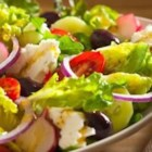 Greek Salad by Filippo Berio(R) - Loaded with fresh salad veggies like lettuce, radishes, bell pepper, cucumber, and tomatoes and seasoned with a blend of herbs, this salad is finished with extra virgin olive oil and red wine vinegar for a light lunch or dinner side.