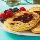 PB and J Swirled Oatmeal Pancakes - Creamy peanut butter and delicious fruit spread swirls are a fun new twist on classic pancakes.