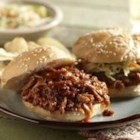 BBQ Pork Sliders - Pork roast slow cooked in a sweet and spicy barbecue sauce makes for a crowd-pleasing platter of pulled pork sliders.