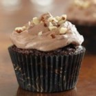 Brownie Cupcakes with Hazelnut Buttercream - These easy brownies are loaded with chopped hazelnuts, then they're topped with swirls of creamy chocolate-hazelnut frosting.