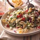 Creamy Mediterranean Pasta Salad - A perfect summer lunch or dinner, this pasta salad with spinach, grape tomatoes, and crumbled feta cheese is tossed with a creamy lemon and herb sauce.