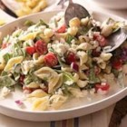 Philly Mediterranean Pasta Salad - Pasta is tossed in a creamy sauce with lemon zest, spinach, grape tomatoes, chopped red onions, and feta cheese--it's a perfect picnic salad for a crowd.