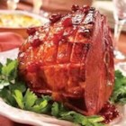 Cherry Glazed Ham - Glazed with a sweet and spicy mixture of cherry, cinnamon, nutmeg and cloves, this roasted ham will take center stage on your holiday table.