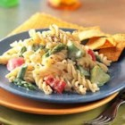Rotini and Sweet Pepper Primavera - Primavera means 'springtime' in Italian. This creamy pasta recipe is full of spring asparagus, sweet peppers, and squash.
