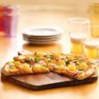 Canadian Bacon and Pineapple Pizza - Chunks of pineapple add a juicy tropical twist to the Canadian bacon and provolone cheese flavors in this family-pleasing pizza.