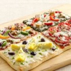 4-Square Family Pizza - Let your family's creativity run wild with this fun pizza that features four different delicious topping portions.