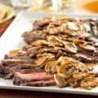 Flank Steak with Mushroom Sauce - Trendy and tasty, this skillet recipe is a simple and delicious way to prepare flank steak...and the flavorful sauce is absolutely divine!