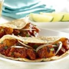 Home-style Tacos al Pastor (Chile and Pineapple Pork Tacos) - Tacos al Pastor are a favorite in Mexico and Mexican restaurants throughout the world for good reason. We've taken the delicious, authentic flavors that make these tacos so special, and adapted the recipe for your home kitchen, so you can enjoy it whenever a craving strikes!