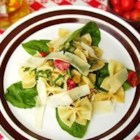 Pasta Carcione - This easy pasta dish is very colorful and features the creamy tart flavor of goat cheese. Juicy red tomatoes and thin strips of garden-fresh spinach are tossed with hot farfalle and olive oil. Crumble goat cheese over the top and serve warm.
