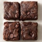 Whole-Wheat Dark Chocolate Zucchini Brownies - Moist, chocolatey, and delicious, these double-chocolate brownies will disappear fast.