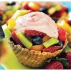 Fruit and Yogurt Treats - Ice cream cones filled with fruit and topped with PB&J yogurt make a refreshing treat any time of the day.