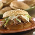 Pulled Pork Sandwiches - Pork braised to tenderness with flavorful Pace(R) chunky salsas, cranberry sauce, mustard and brown sugar makes irresistible sandwiches topped with cole slaw.