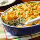 Cheesy Tuna Dinner - This quick, one-pan dinner is made with cream of mushroom soup, milk, tuna, green peas and Minute(R) Rice topped with shredded Cheddar cheese.