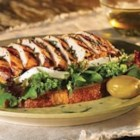 Open-Faced Grilled Tuscan Chicken Sandwiches with Fresh Mozzarella - Marinated, grilled chicken with rosemary is served on slices of grilled rustic bread with baby greens and fresh mozzarella cheese.