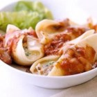 Cheese and Nut Stuffed Shells - Walnuts add crunch to these meatless mozzarella and Parmesan cheese-filled pasta shells.