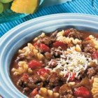 Hearty Lasagna Soup - The classic flavors of traditional lasagna are featured in this hearty soup starring Swanson(R) Seasoned Beef Broth with Onion, tomatoes, tender beef, garlic, Italian seasonings, pasta and cheese.