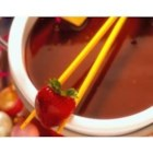 Fudgy Milk Chocolate Fondue - Perfect for a party, dip your favorite fruit, cookies, or other sweet treats in this decadent milk chocolate fondue.
