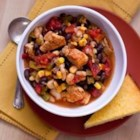 Chicken Chili with Black Beans and Corn - Chili powder, cumin, red pepper and garlic powder make this chili so rich and hearty your friends will never be able to tell you left out the fat.
