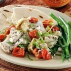 Greek Chicken with Tomatoes, Artichokes and Feta - Chunks of chicken, grape tomatoes, marinated artichoke hearts, feta cheese, and olives are baked with Greek seasoning for this easy Mediterranean-inspired dish.