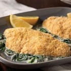 Tilapia Florentine - Crumb-crusted baked tilapia fillets are served over spinach in a creamy lemon and herb sauce.