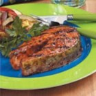 Firecracker Salmon Steaks - Red pepper flakes and cayenne provide the fiery flavor that gives these salmon steaks their name. Basting the fish with the zippy sauce while grilling creates a glossy glaze.            --Phyllis Schmalz of Kansas City, Kansas