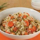 Veggie Pilaf with Pine Nuts - Brown rice with carrots and fresh rosemary is combined with toasted pine nuts, green peas, and garlic for a colorful and hearty side dish.