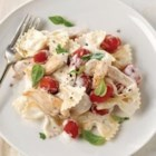 Chicken Bruschetta Pasta - Succulent chicken strips are sauteed, then simmered with tomatoes in rich PHILADELPHIA Original Cooking Creme, and served with piping hot bow-tie pasta and fresh basil.