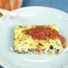 Fiesta Frittata Casserole - Quick and easy, this baked egg dish is perfect for brunches, picnics, parties, and other gatherings. Cheese, diced chile peppers, green onion, bacon, black beans, and corn are whisked into eggs and baked. You can cut the cooked casserole into small squares and serve with toothpicks and salsa for dipping.
