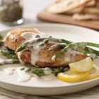 Creamy Chicken Piccata and Asparagus - Browned chicken breast halves are simmered in a creamy lemon and herb sauce and served with fresh, crisp-tender asparagus.