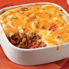 Updated Shepherds Pie - An easy shepherd's pie made with lean ground beef has a light but flavorful layer of creamy mashed potatoes on top.