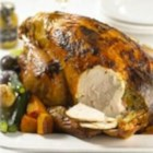 Glazed Turkey with Maille(R) Honey Dijon Mustard - This roast turkey is filled with a flavorful stuffing of bacon, Dijon mustard, apricots, onions, and breadcrumbs and roasted with root vegetables, celery, and zucchini. It's an elegant and satisfying meal for Thanksgiving, or any special occasion.