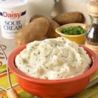 Garlic and Herb Mashed Potatoes - Ordinary mashed potatoes get the royal treatment with the addition of fresh herbs, garlic and Daisy Brand Light Sour Cream.