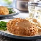 Baked Pork Chops and Gravy - You make the breading for these mouthwatering pork chops with stuffing mix...it couldn't be easier or more delicious.