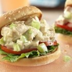 Picnic Chicken Salad Sandwiches - Cream of celery soup is the secret ingredient that makes this chicken salad creamy and flavorful...served on sesame seed sandwich buns, these sandwiches can be put together in just 15 minutes.