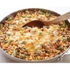 Southwestern Beef Skillet - An easy one skillet meal made with ground beef, rice, and mixed vegetables seasoned with chili powder and salsa.