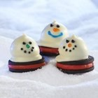 Melting Snowmen OREO Cookie Balls - Cold weather got you down? Bring the outdoors in with these cool confections, sure to make a winter lover out of everyone.