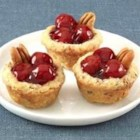 Mini Cherry Pecan Pies - Enjoy a whole cherry pie in just two bites! These little cherry-pecan pies are as delicious as they are cute.