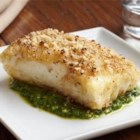 Crusted Halibut Filet with Arugula Pesto - The combination of walnuts, breadcrumbs and butter makes for a delicious and crispy topping. Try it with other meats including pork, beef or chicken.