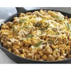 One-Pot Salsa Beef Skillet - Macaroni and cheese goes Tex Mex with the addition of ground beef, salsa, corn, and shredded cheese.
