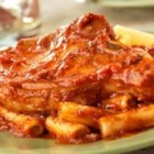 Italian-Style Skillet Pork Chops - As good as your favorite restaurant, these pork chops are browned then finished in prepared Italian sauce and served over ziti . . . they're easy and exquisite!
