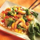 Mandarin Shrimp and Vegetable Stir Fry - Shrimp is quickly stir fried with garlic, broccoli and peppers, then covered in a spicy orange sauce made with SMUCKER'S(R) Orange Marmalade. This tastes great sprinkled with green onion and served over steamed rice.