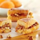 Melted Brie and Apricot Petite Croissants - For a special brunch treat, fill croissants with brie, apricot preserves, pecans, and brown sugar, and heat until golden brown in a skillet before serving.