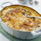 Creamy Scalloped Potatoes - Scalloped potatoes with lots of cheese and a hint of garlic in a creamy sauce are a classic, crowd-pleasing side dish.