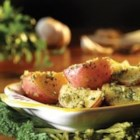 Roasted Walnut Pesto Potatoes - Potatoes roasted with garlic and olive oil are tossed with homemade pesto with walnuts for a truly memorable side dish.