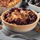 Blueberry-Pecan Crisp - This simple blueberry and pecan crisp is quick to make thanks to the packaged yellow cake mix. Serve warm, topped with ice cream.